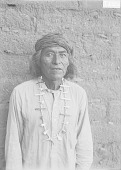 view Man in Partial Native Dress with Necklace Near Adobe Wall 1911 digital asset number 1