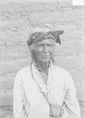 view Man with Ornaments and Medicine Pouch Near Adobe Wall 1911 digital asset number 1