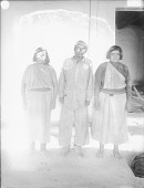 view Man and Two Women Near Adobe House, All in Partial Native Dress 1899 digital asset number 1