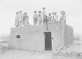 view Group of Thirteen Natives and Non-natives On Adobe House Roof 1911 digital asset number 1