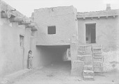 view Boy Near Covered Walkway in Pueblo 1911 digital asset number 1