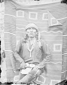 view Man in Native Dress with Concha Belt and Ornaments; Blankets Hanging On Adobe Wall in Background 1879 digital asset number 1