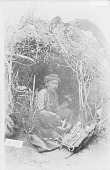 view Silversmith in Brush Arbor with Implements, Squash Blossom Necklace, and Ornaments Nearby 1880 digital asset number 1