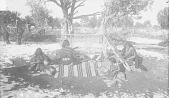 view Group of Four under Trees, Charley at Blanket Loom, Nadespa Carding Wool, Woman at Belt Frame, Woman Spinning Dress with Ornaments 1893 digital asset number 1