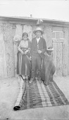 view Jake, SIlversmith, his Wife, and Brother-In-Law,, All near Wood Frame Building, 1892 digital asset number 1