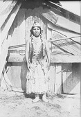 view Woman in Native Dress with Ornaments Near Wood House 1908 digital asset number 1