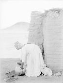 view Woman Placing Olla or Water Jar On Head; Adobe House Nearby 1894 digital asset number 1