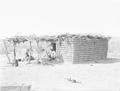 view Josa in Doorway of Adobe House and Brush Arbor, His Wife Making Cheese Nearby 1894 digital asset number 1