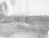 view Two Abandoned Mud and Pole Houses; Man Nearby 1900 digital asset number 1