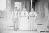 view Two Women and Man Near Wood and Brick House 1892 digital asset number 1