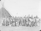 view Group of Twenty-Three Chiefs, All in Partial or Native Dress with Ornaments, Tipi in Background 1900 digital asset number 1