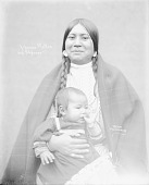 view Woman in Partial Native Dress with Ornaments and Holding Child 1900 digital asset number 1