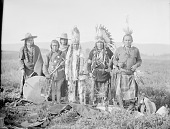 view Group of Six Men, Participants in War Dance, All in Partial Native Dress with Ornaments, One Holding Drum, One Holding Pipe, One Holding Staff 1903 digital asset number 1