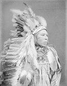 view Portrait (Profile) of George Marshall in Native Dress with Headdress and Bear Claw Necklace 1900 digital asset number 1