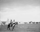 view Mrs No Shirt in Native Dress On Horseback and Holding Bag; Tipis in Background 1900 digital asset number 1