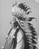 view Portrait (Profile) of Hinmaton-Yalatkit or Hin-Ma-Toe-Ya-Lut- Kiht (Thunder Coming From The Water Up Over The Land, Called Chief Joseph, in Partial Native Dress with Ornaments and Headdress APR 1900 digital asset number 1