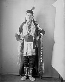 view Portrait (Front) of Stephen Reuben, Interpreter, in Native Dress with Face Paint and Ornaments APR 1900 digital asset number 1