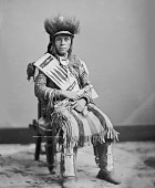 view Portrait (Front) of Oscar Mark or Little Vessel in Native Dress with Headdress and Holding Pipe-tomahawk 1877 digital asset number 1