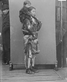 view Portrait of Woman Carrying Child On Shoulders, Both in Native Dress MAR 1894 digital asset number 1