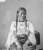 view Portrait (Front) of Wife of Chief Sinte-Galeshka or Cin-Te-Gi- Le-Ska or Tshin-Tah-Ge-Las-Kah (Spotted Tail) in Native Dress with Ornaments 1872 digital asset number 1