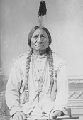 view Portrait (Front) of Tatanka Yotanka (Sitting Buffalo Bull), Called Sitting Bull, When Younger Called Jumping Badger, Medicine Man, in Native Dress with Ornaments and Holding Pipe 1885 digital asset number 1