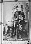 view Portrait (Front) of Tatanka Yotanka (Sitting Buffalo Bull), Called Sitting Bull, When Younger Called Jumping Badger, Native Doctor, in Partial Native Dress and Holding Pipe and Bag 1885 digital asset number 1