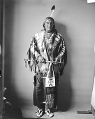 view Portrait (Front) of Chief Taopi Cikala (Little Wound) in Native Dress with Peace Medal and Holding Pipe and Bag MAR 1896 digital asset number 1