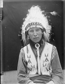 view Portrait (Front) of Pehi Zi (Yellow Hair), Member of 101 Ranch Show, in Partial Native Dress with Headdress AUG 1907 digital asset number 1