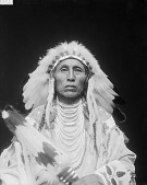view Portrait (Front) of Perits-Shinakpas or Paretche-Mark-Bosh, Called Medicine Crow, wearing regalia 1913 digital asset number 1