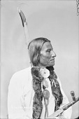 view Portrait (Profile) of Tatanka Wanaghi or Tatanka Wanagi or Tatanka Wanaxi or Tah-Tun-Ka-We-Nah-Hi (Buffalo Bulls Ghost) or (Bulls Ghost) in Partial Native Dress with Andrew Johnson and Martin Van Buren Peace Medals and Holding Pipe 1884 digital asset number 1