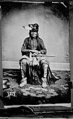 view Portrait (Front) of Chief Palaneapape (Struck A Pawnee) or Padani Apapi or Pa-Da-Ni-A-Ha-Hi (Struck by the Ree) in Partial Native Dress with Headdress and Holding Pipe-tomahawk 1867 digital asset number 1