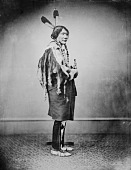 view Portrait (Profile) of Tatanka Wakan (Medicine Bull) in Native Dress and Holding Pipe-tomahawk 1877 digital asset number 1