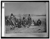 view Miniconjou Indians, including Gray Eyes, Running Water, Mrs. Moran, Young Elk, and children, near fire and cooking pots digital asset: Miniconjou Indians, including Gray Eyes, Running Water, Mrs. Moran, Young Elk, and children, near fire and cooking pots