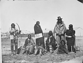 view Group of Brule men, women, and children, including One Who Trades, Mrs Grey Eyes, Thigh, and Bear's Tooth digital asset: Group of Brule men, women, and children, including One Who Trades, Mrs Grey Eyes, Thigh, and Bear's Tooth