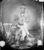 view Portrait (Front) of Minchu Zhinga (Young Grizzly Bear) or (Little Bear) in Native Dress with Bear Claw Necklace, Headdress and Ornaments and Holding Sword 1869 digital asset number 1