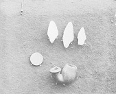 view [Poosepatuck relics: 3 arrowheads, a pipebowl, and a George Washington coin] July 24, 1909 digital asset number 1