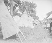 view Tipis and Mat-Covered Lodge at Pow Wow 1907 digital asset number 1