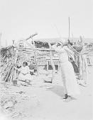 view Woman carrying burden pack 1900- 1920 digital asset number 1