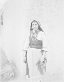 view Girl in Native Dress with Ornaments Near Adobe Wall 1900 digital asset number 1