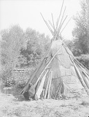 view Woman? in Doorway of Woven Mat Covered Tipi SEP 1907 digital asset number 1