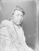 view Blackfoot man wearing Pendleton blanket ca 1900-1920 digital asset number 1