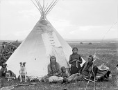 view Blackfoot man Carlisle Ironbreast and family seated in front of tipi AUG 23 1909 digital asset number 1