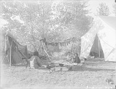 view Woman? and Two Children Eating Meal Near Tent and Drying Meat n.d digital asset number 1