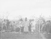 view Group of People Near Ceremonial Lodge, Two in Partial Native Dress and Holding Rattles n.d digital asset number 1