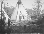 view Bear Ground (Man) Holding Child Outside Tipi; and Open Eye Old Lady; Child 1910 digital asset number 1