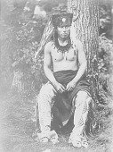 view [Carey (or Caryl) La Flesche, brother of Francis La Flesche, seated outdoors] Fall, 1902 digital asset number 1
