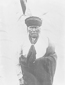 view [Pedi (Pethi) gahige or Jonathan Parker standing in front of the sacred tent of the White Buffalo Hide, Omaha Reservation, Nebraska] ca. 1890-1895 digital asset number 1