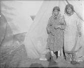 view [Two Eskimo women in front of a canvas tent] digital asset number 1