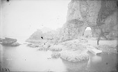 view Man and Small Boat Beside Natural Arch in Cliff 1881 digital asset number 1