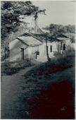 view [Manoel in front of fetish house of Omolu (Obaluaiê) by Gantois temple], 1938 September digital asset number 1